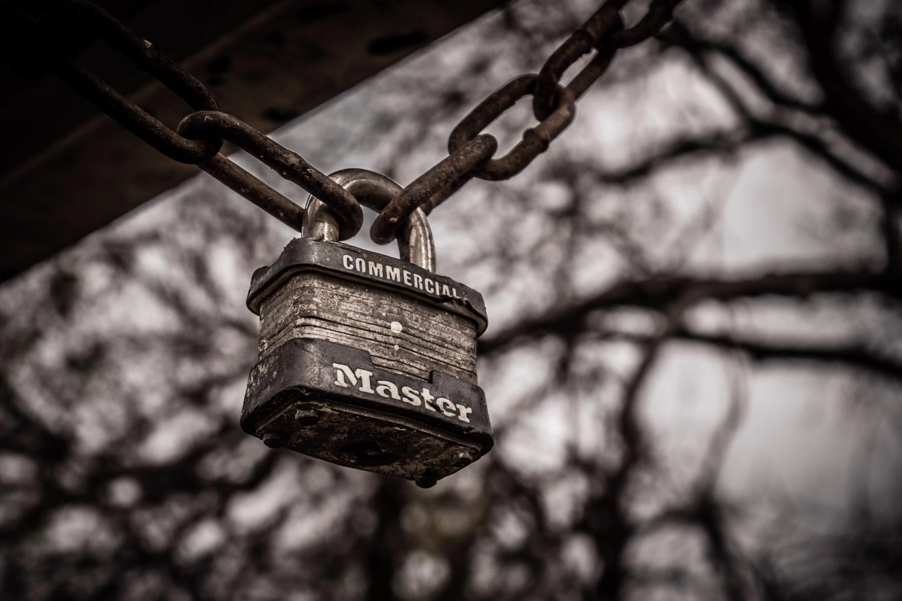 Locked padlock hangs chain Rich - mattgharvey | ello
